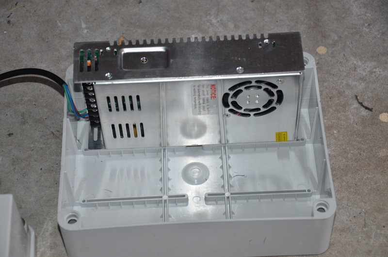 Here we see a standard PSU in place in the box. It takes up about 1/3 the width of the box, and this means you could easily fit 2 of these PSU's on their side like this, and maybe even a small controller like P2 or two, as well as fuses if you design the layout carefully