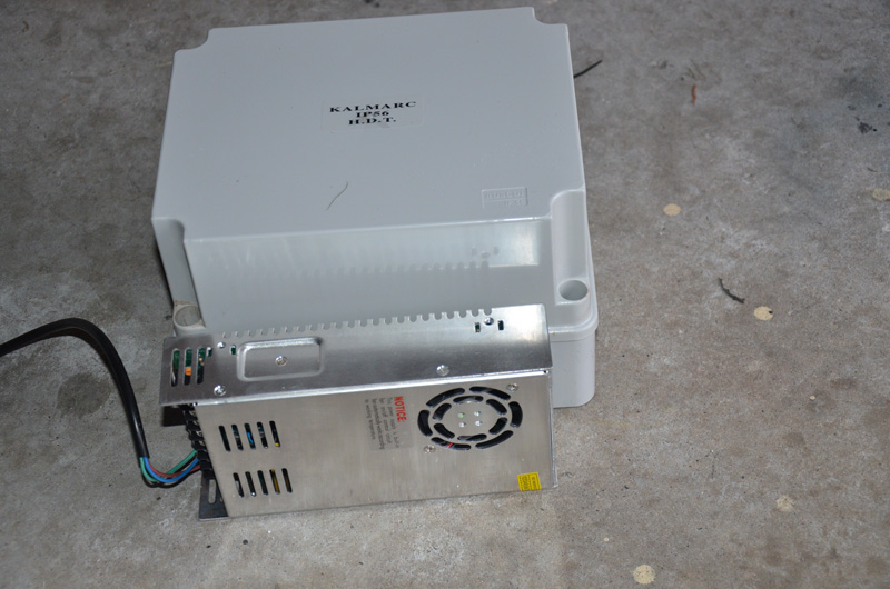 This shows the height of the box and lid compared with a PSU on its side