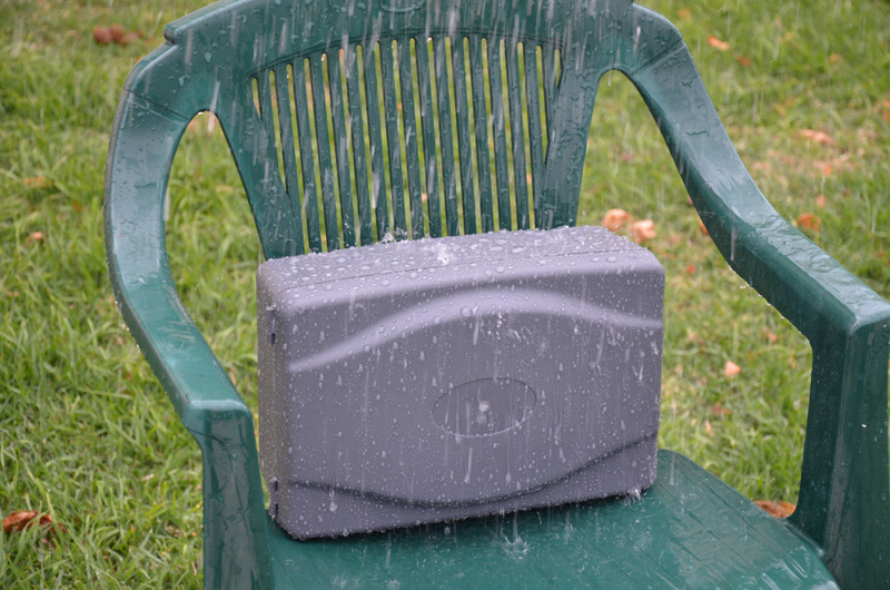 A sprinkler was hung from the clothes line above to rain what would be a moderate rainfall down on the box for 10 minutes. The box was sitting up to allow any water to drain away from below it, so no water got in through the cable entry below.