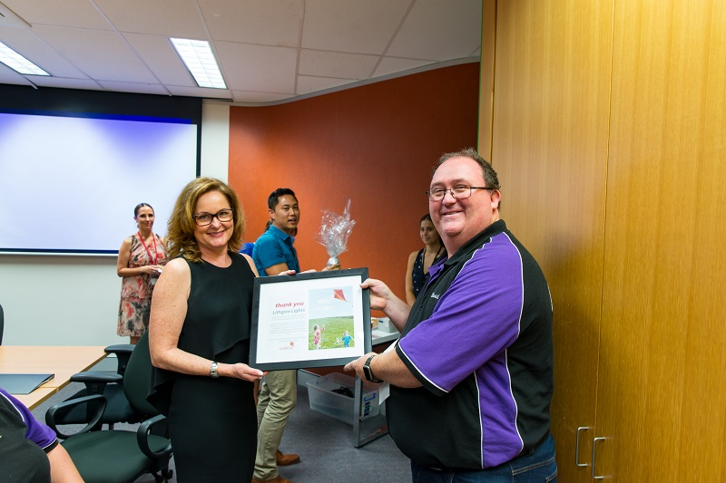 Redkite CEO Jenny Seaton presents David Rawsthorne with a thank you (That sits proudly in the shed!)