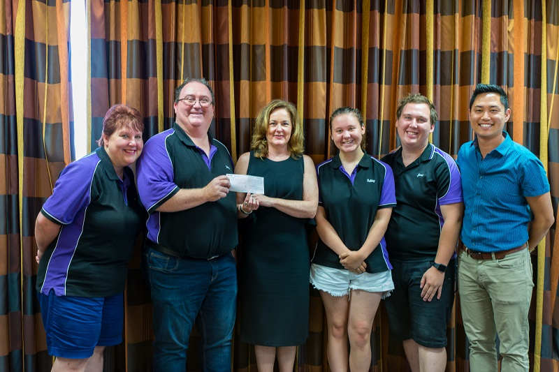 The LithgowLights crew present the cheque to Redkite CEO Jenny Seaton