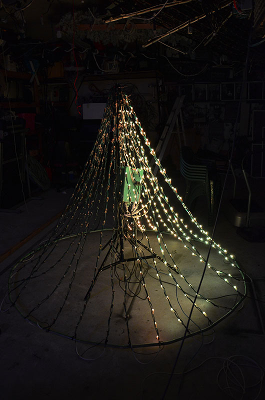 In order to test the modified rose garden setup, a rough mockup was completed in the shed and run through its paces. This upgrade will increase the lights from 12 vertical strings up to 32 strings making it look much fuller this year. The lights were modified from damaged Stellascapes ones used in the trees in previous years